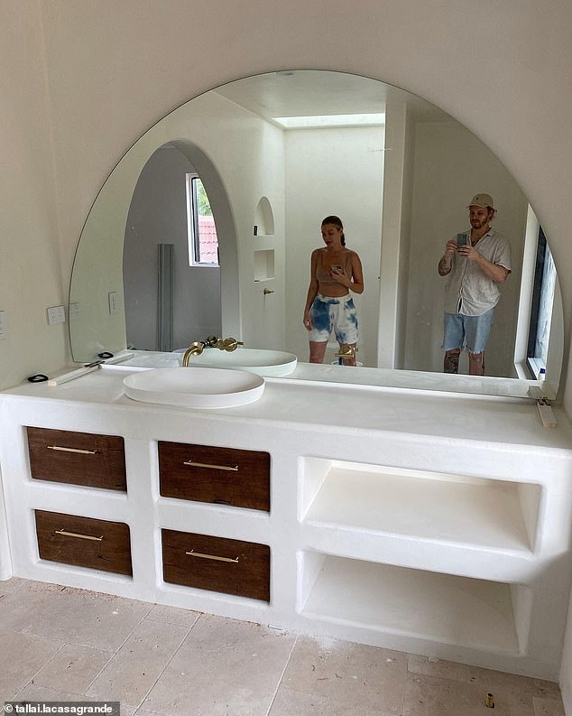 Well done: Skye and her partner Lachlan Waugh (above) kept fans up to date with the renovation, sharing before and after photos of how they turned their crumbling home into a luxurious pillow