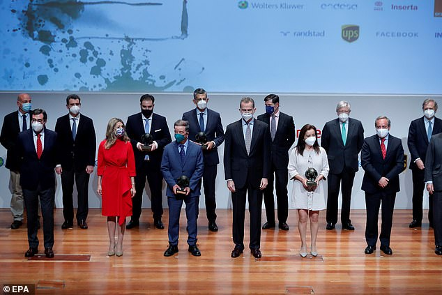 Felipe and Yolanda posed next to the lucky prizewinners during the annual awards ceremony atReina Sofia Museum on Thursday