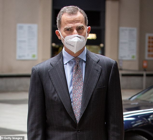 The Spanish royal kept himself protected amid the ongoing Covid-19 crisis by sporting a white face mask as he arrived at the event, while his wife Queen Letizia, 48, was not present