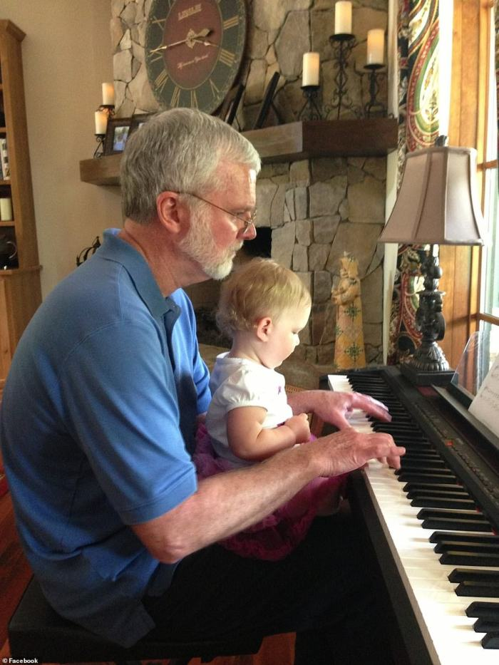 Lesslie is pictured playing the piano with his granddaughter Adah, who was among the people killed on Wednesday