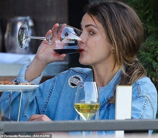 Having a ball: Keri Russell was spotted tipping back a glass of red wine while out with her gal pals in New York City this week