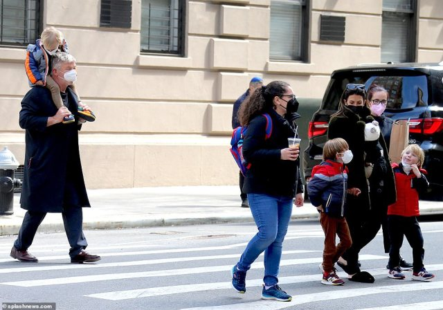 Bundles of joy: The Baldwin family were out in full force with nearly all of their six children for a city stroll