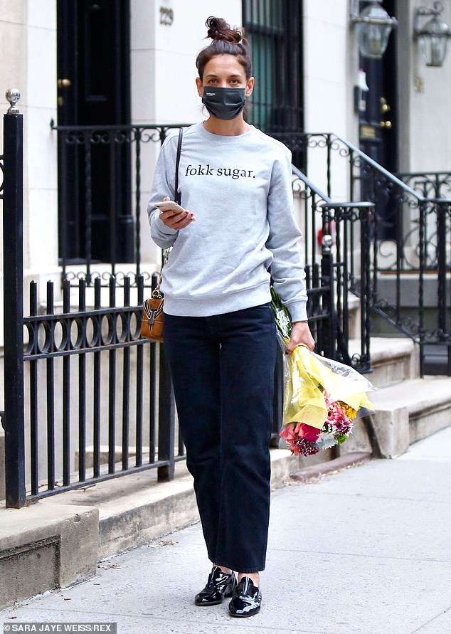 Doing her own thing: Thursday morning, Katie Holmes was spotted going out shopping for flowers without her boyfriend Emilio Vitolo Jr in New York City.