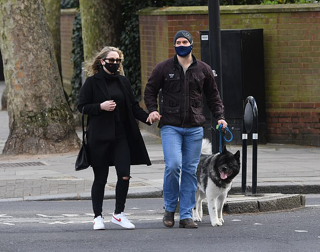 Loved-up!Henry appeared the picture of happiness as he was seen for the first time with his new blonde girlfriend earlier this week