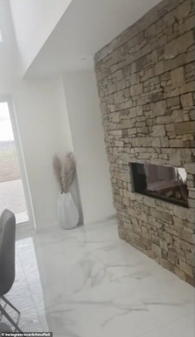 Cool:Onto the living room and it was certainly clear that the TV favourite had put a lot of thought into the design, with the large room separated fro the kitchen with a showstopping double-sided stone wall fireplaces