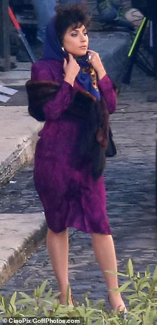 Ready to film: Gaga could be seen altering her scarf while waiting to film scenes