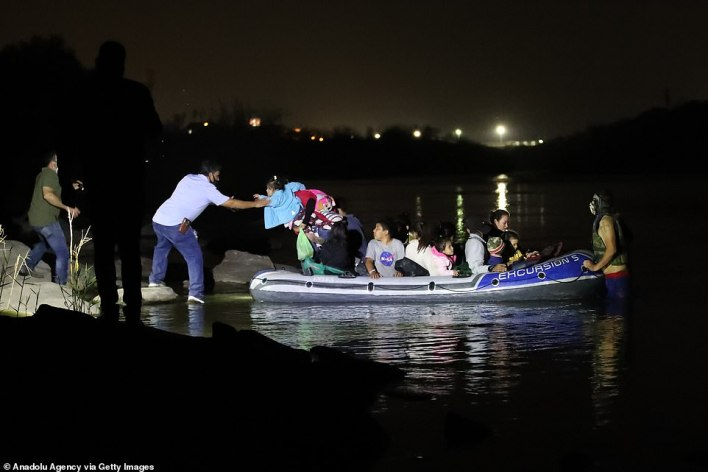 A group fromHonduras, Guatemala and El Salvador are seen crossing the Rio Grande River into the United States on Wednesday