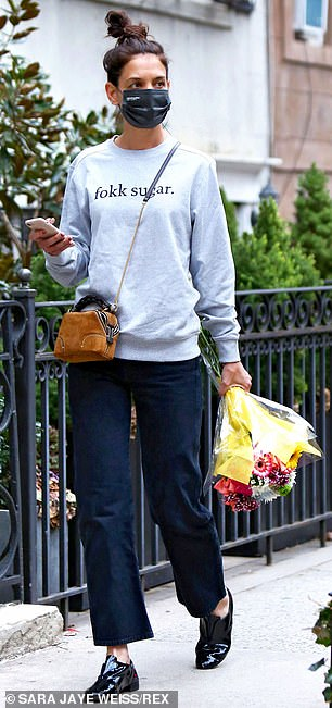Staying comfortable: The Dawson's Creek actress wore a gray crewneck sweater while stepping out