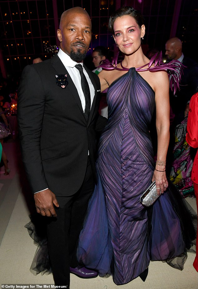 Moving on: Holmes was previously in a low-key relationship with Jamie Foxx that eventually came to an end in 2019; the two are pictured during that year's Met Gala