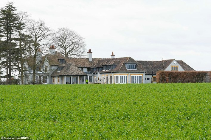 Police guard Sir Richard's £2million property yesterday. The landowner, 83, who owns twice as much land as the Ministry of Defence - is estimated to be worth £301million