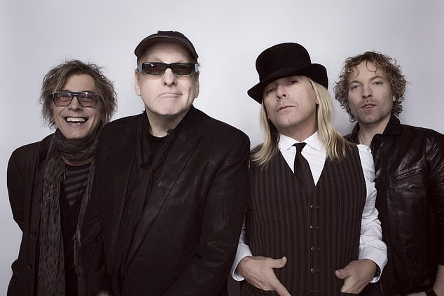 'We're too dumb to quit,' says guitarist Rick Nielsen of Cheap Trick. A Midwest institution since they began playing in Illinois bowling alleys and warehouses in the 1970s, the blue-collar rockers avoid new-fangled modern trimmings on In Another World