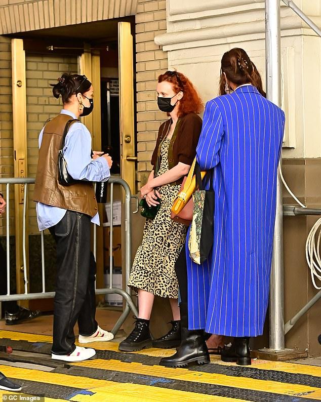 Earning her fashion stripes! Irina Shayk stood nearby wearing a long blue striped coat