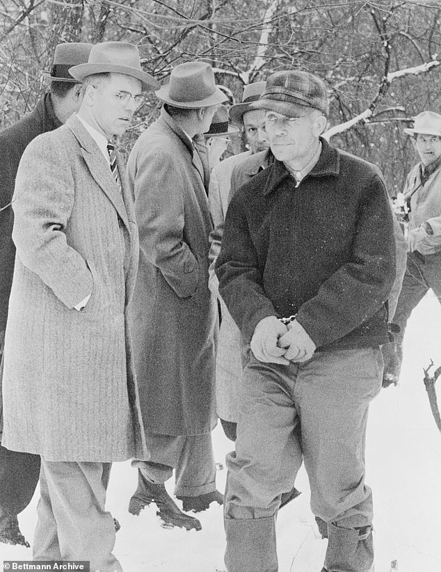 Gein is pictured on his 160-acre farm after discovery of the mutilated and headless body of a 58-year-old woman and ten skulls on his property
