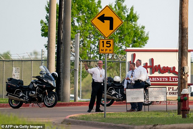 Bryan police officers work the scene of a mass shooting at Kent Moore Cabinets in Bryan, Texas on Thursday