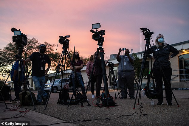 Members of the media wait for the start of a press conference outside of CHI St. Joseph Health Regional Hospital, where people wounded during a shooting at Kent Moore Cabinets are being treated