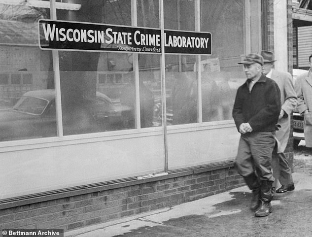 Edward Gein, owner of Plainfield, Wisconsin farm where butchered body of Bernice Worden was discovered hanging in a shed, is shown as he was taken to the state crime laboratory to face a lie detector test