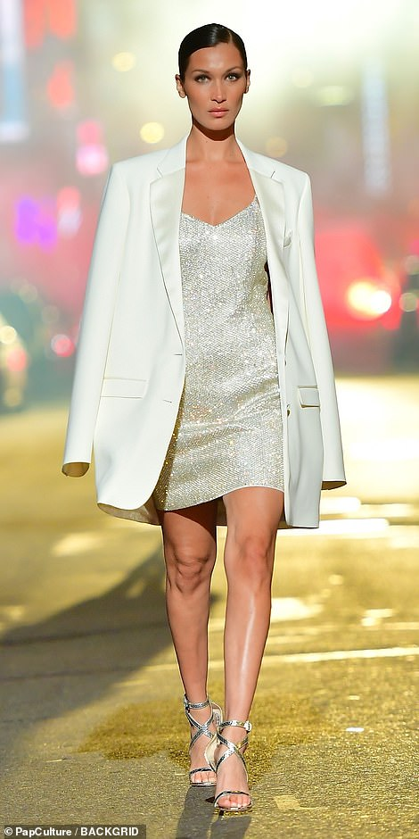 Woman in white: Bella showcased her toned legs in an elegant white mini dress as she strutted down Manhattan's normally packed Broadway