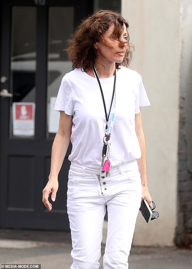 Casual:She kept her look casual by wearing a pair of white jeans which she paired with a loose-fitting white T-shirt and sneakers