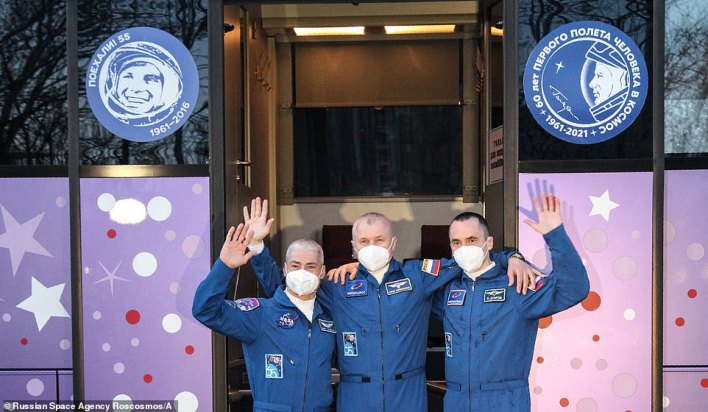 From left, Expedition 65 NASA astronaut Mark Vande Hei, Russian cosmonaut Oleg Novitskiy and Russian cosmonaut Pyotr Dubrov, waving farewell as they depart from a hotel at the Baikonur Cosmodrome in Kazakhstan