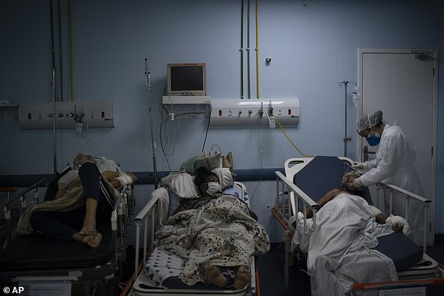 Patients are treated on a Covid ward at a hospital in Rio de Janeiro state, Brazil, as they wait to be tested for the virus
