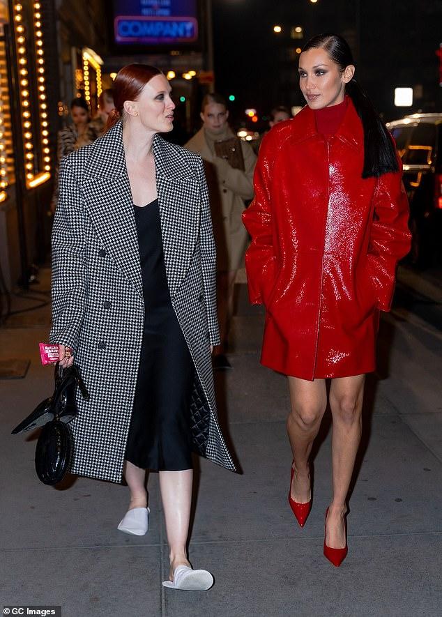 Model behaviour: Brunette Bella was also seen chatting away with fellow model Karen Elson