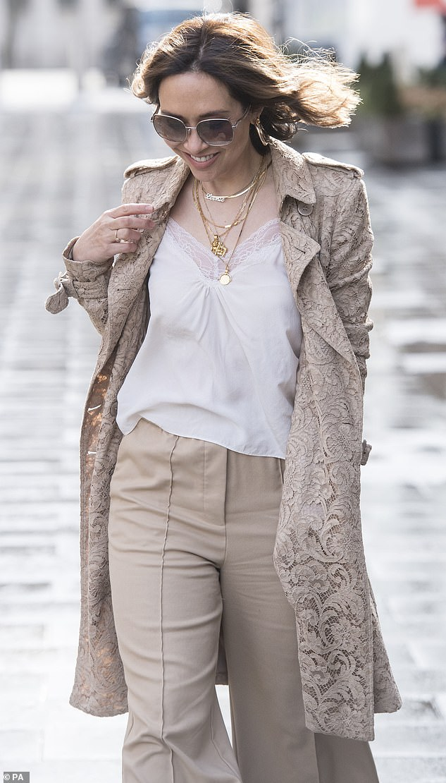 All smiles:Keeping her look effortless, she added a white lace-trimmed camisole and added layered gold necklaces over the top and styled her caramel locks in subtle waves