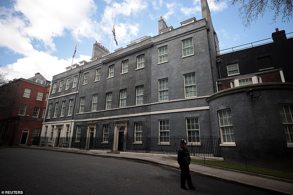Union Flags fly at half-mast on top of Downing Street after it was announced Prince Philip died on Friday morning aged 99
