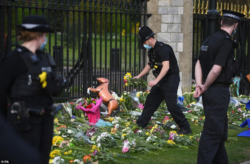 Flowers at Cambridge Gate at Windsor Castle, Berkshire. It was today announced that Prince Philip had died aged 99