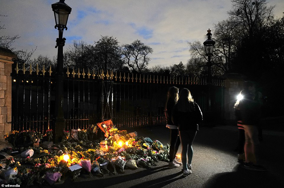 Flowers were scattered on the ground outside Windsor Castle today in tribute to Prince Philip