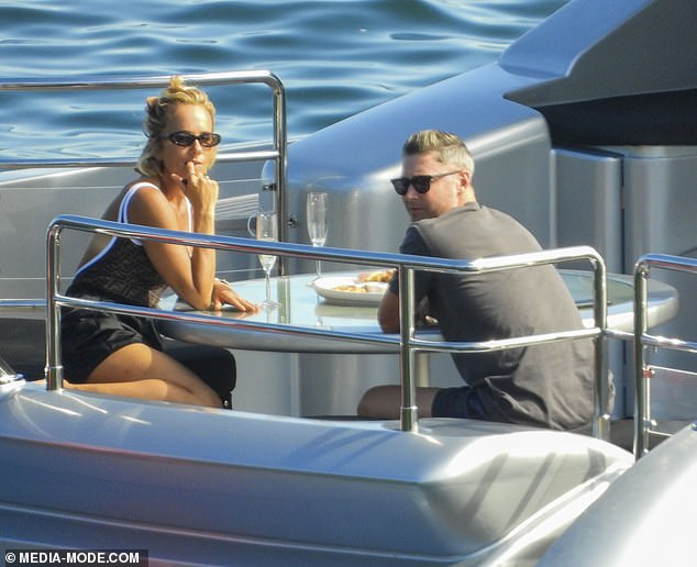 Toasting to romance? On Friday,Michael Clarke and swimsuit-clad Pip Edwards were spotted looking cosy over a couple of champagnes amid reconciliation rumors on board Anthony Bell's yacht