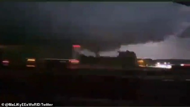 Video posted to social media shows a tornado making its way through Pelahatchie, Rankin County, late Friday night, as a tornado siren sounds in the background