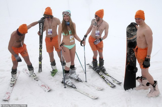 Coordinated: Skiers and snowboarders braved the 9 C temperatures and wore almost nothing while attending the annual festival