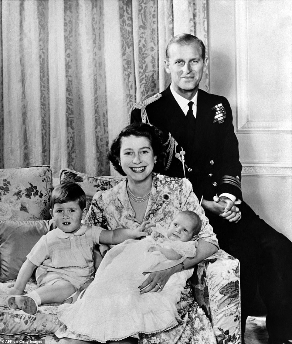 Queen Elizabeth poses with her husband Prince Philip, Duke of Edinburgh and their children Prince Charles and Princess Anne of England in October 1950