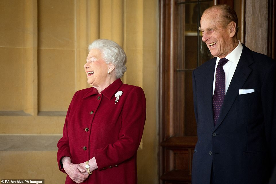 The Queen and the Duke of Edinburgh laugh as they bid farewell to Irish President Michael D. Higgins and his wife Sabina at Windsor Castle after their state visit in April2014
