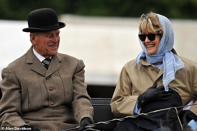 The couple, pictured, shared a love for the exhilarating equestrian sport of horse-drawn carriage riding