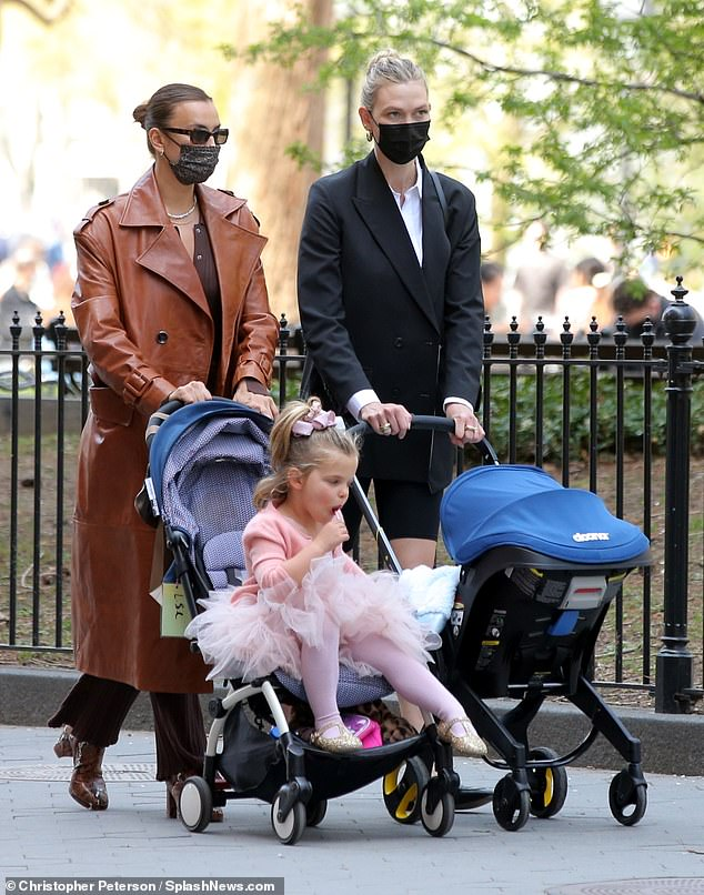 Reunited!  During the fun encounter, which marks Kloss's first public outing with her newborn, new mom, 28, and Shayk, 35, sat side by side on the grass and chatted.