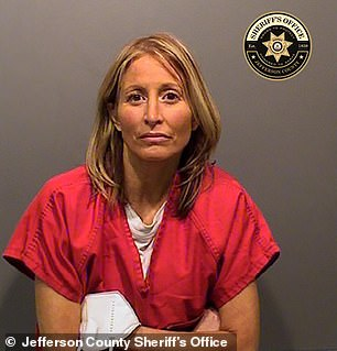 Jennifer Emmi, 43, a well known Colorado animal rights attorney, was charged in January with trying to hire a hit man to murder her husband's girlfriend