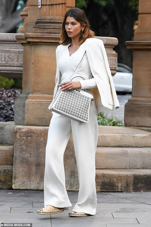 Pleasant!  She paired the look with a pair of woven sandals and a designer handbag in black and white.