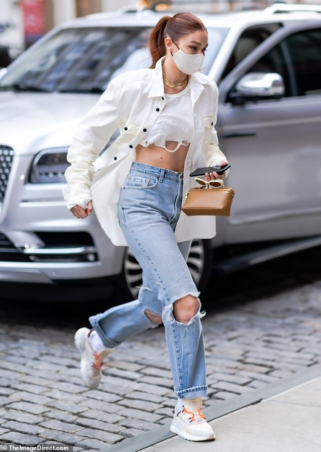 Catwalk star: Gigi Hadid, 25, turned a busy New York City into her personal runway on Saturday when she stepped out after a photoshoot
