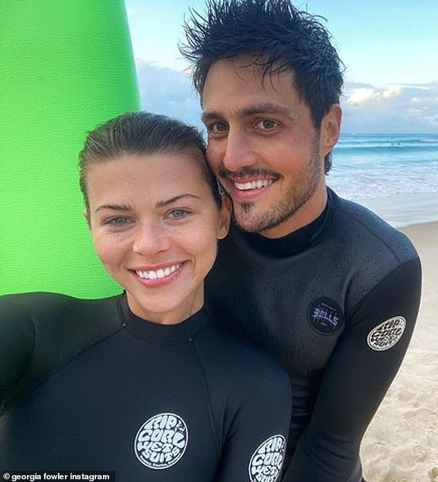 Going strong: Georgia and Nathan confirmed their romance in February of last year.  Last year they welcomed a puppy to their family called Chilli