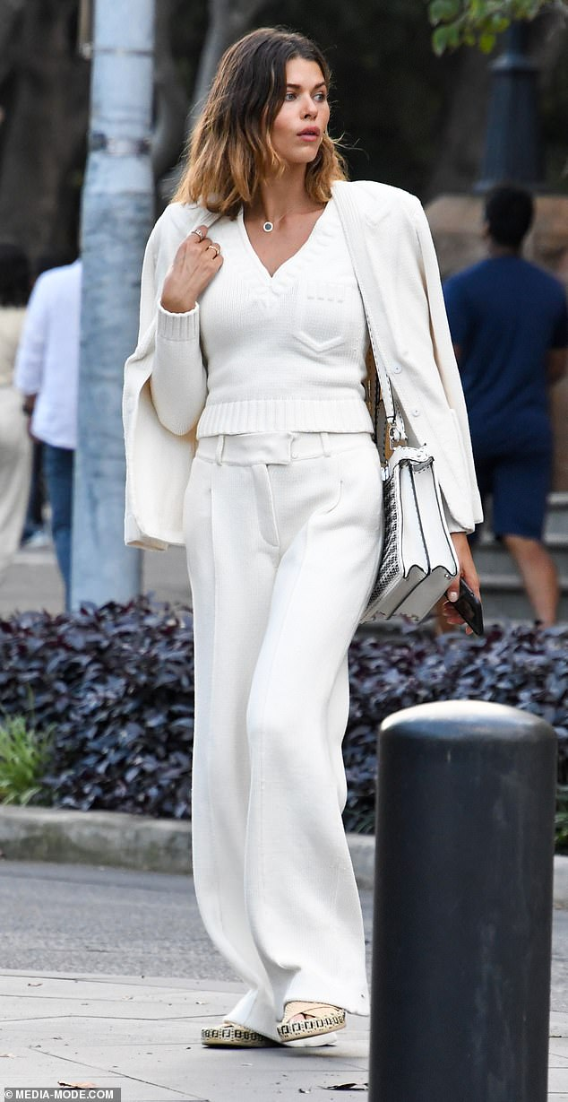 Bump nicely!  Victoria's Secret pregnant model Georgia Fowler, 28 (pictured) looked radiant as she dressed her belly in a chic white ensemble in Sydney on Friday