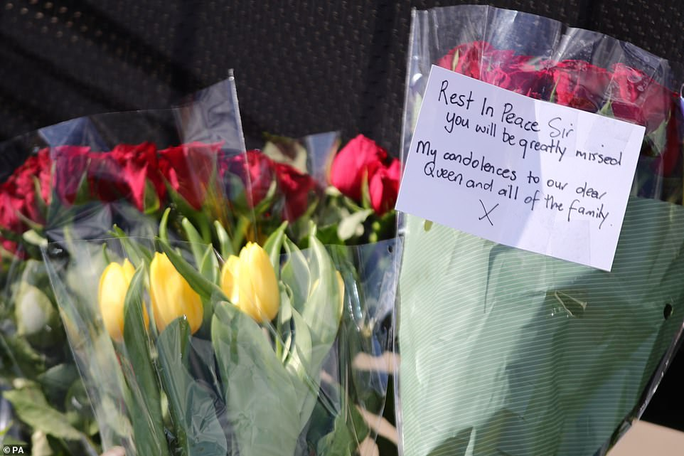 Flowers left outside Buckingham Palace.A note on flowers left paying tribute to the Duke of Edinburgh after his death