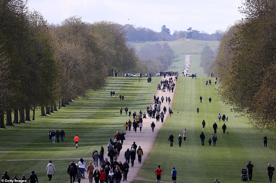 People on The Long Walk at Windsor Castle this morning with royal fans flocking in droves to pay tribute to Prince Philip