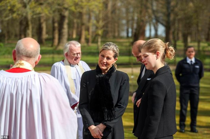 The Earl and Countess of Wessex, with their daughter Lady Louise Windsor, talk to Cannon Martin Poll, Domestic Chaplin to Her Majesty The Queen