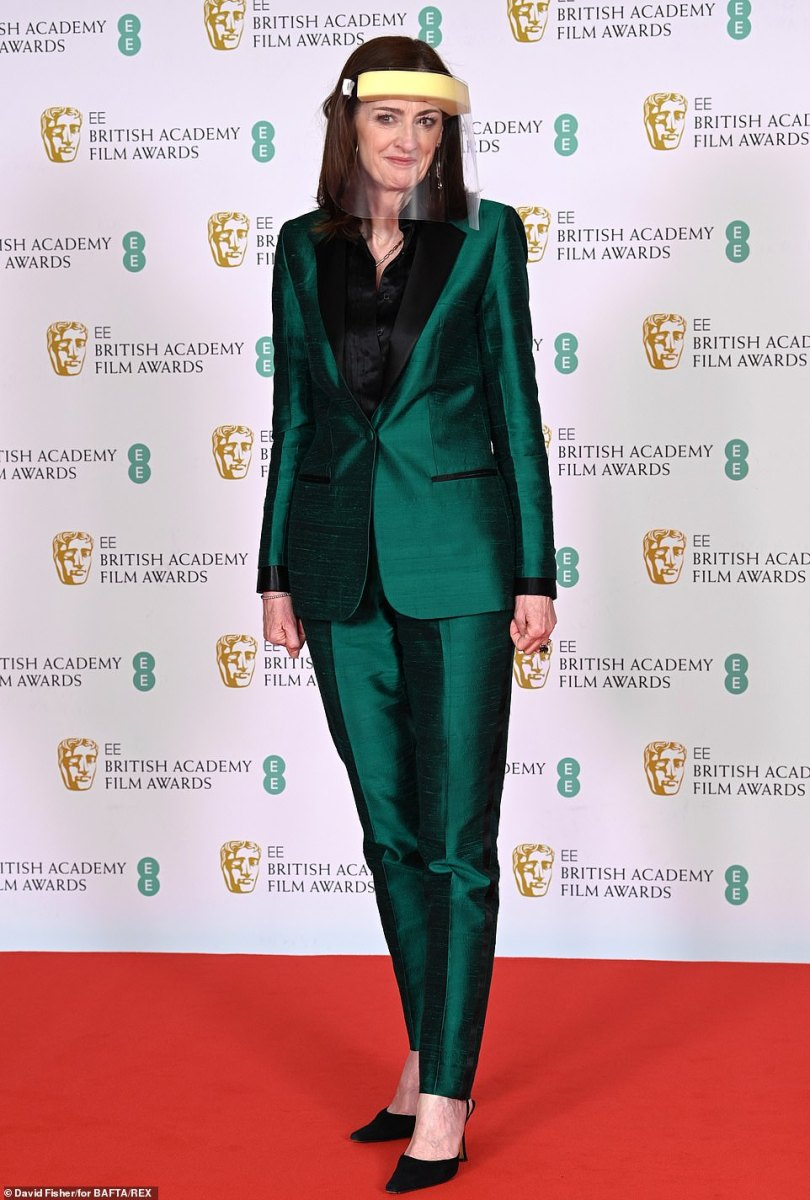 She didn't forget her face covering! Clearly keen to ensure was adhering to the government's coronavirus restrictions, Amanda Berry donned a face shield along with her chic green suit as she headed down the red carpet