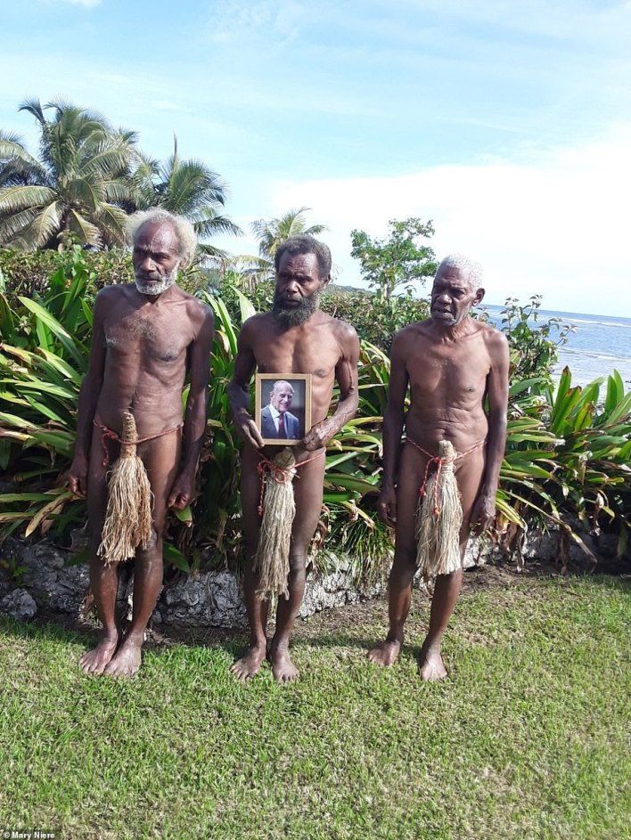Yaohnanen tribesmen on the Pacific Island of Tanna, in Vanuatu, hold a framed photo of Prince Philip following the news of his death