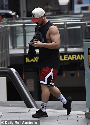 Sporty: Jason wore a black Van Halen singlet, which he paired with a Chicago Bulls cap