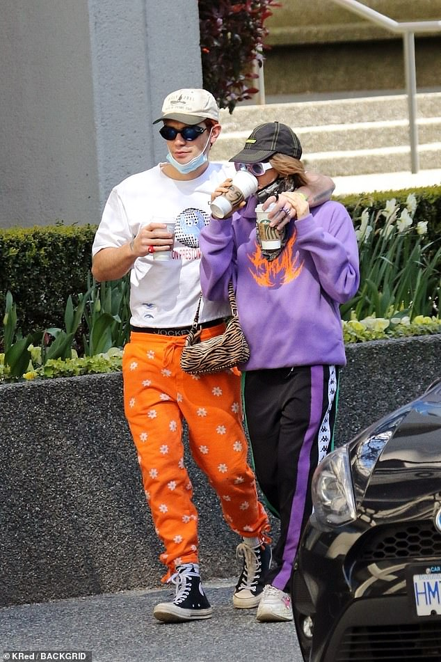 PDA alert! Riverdale heartthrob KJ Apa (L) wrapped his arm around his French girlfriend of two years, Clara Berry (R), after stopping by Starbucks in Vancouver on Monday
