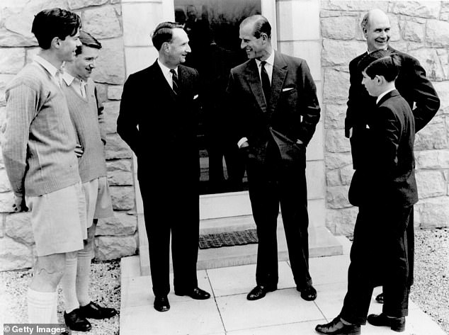April 1962: Prince Philip, the Duke of Edinburgh (centre), talking to housemasters at Gordonstoun School in Scotland where Charles, Prince of Wales (right) was studying