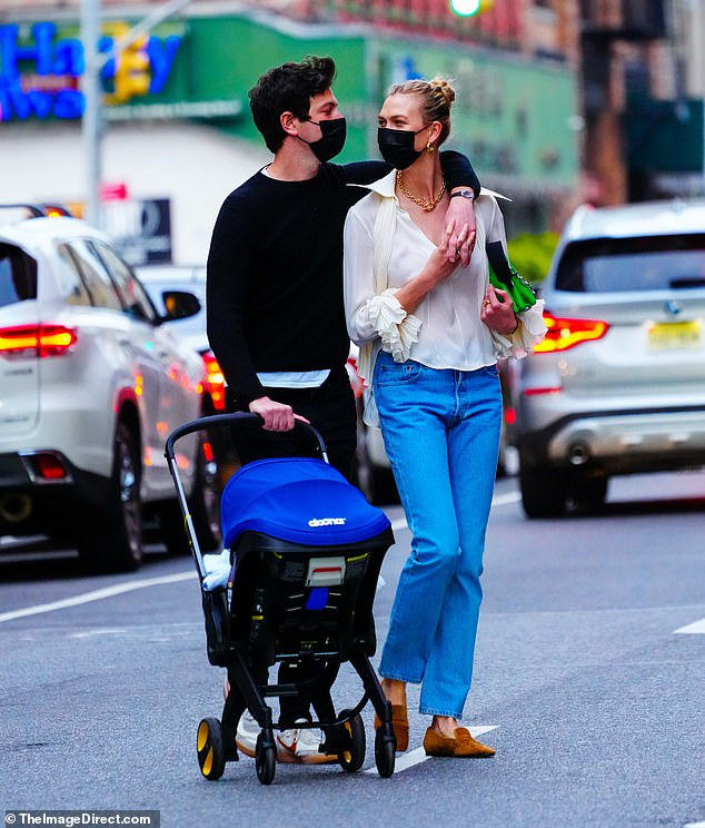 Outside: Karlie Kloss appeared to be enjoying her role as a mom on a walk with husband Joshua Kushner and their newborn baby in New York City this past weekend